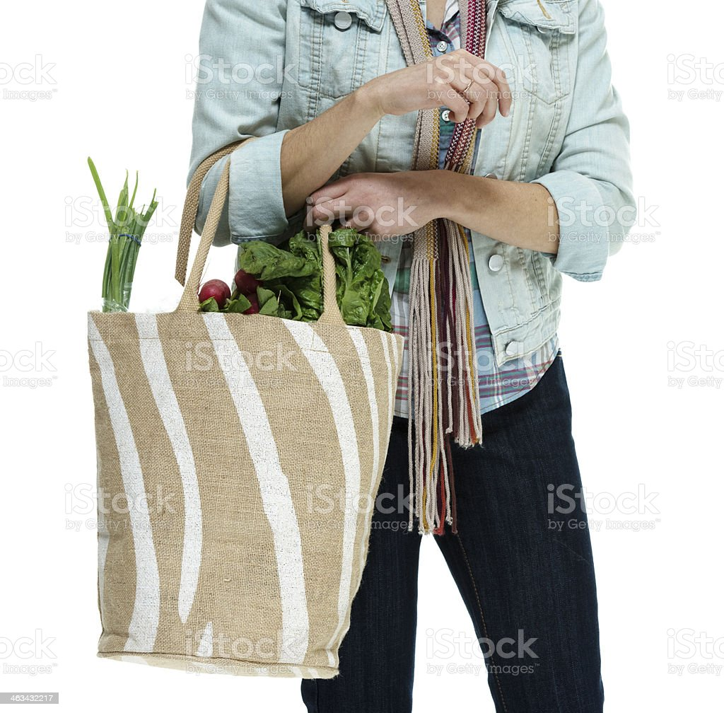 Woman holding a vegetable bag royalty-free stock photo