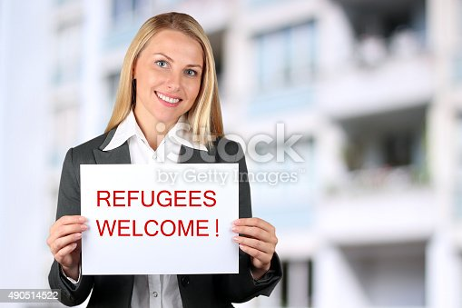 Smiling woman holding a white banner with words