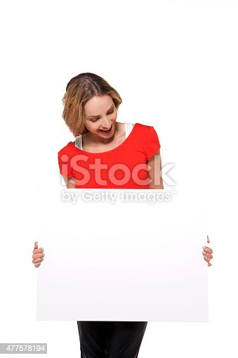 157609352 istock photo Woman holding a white board 477578194