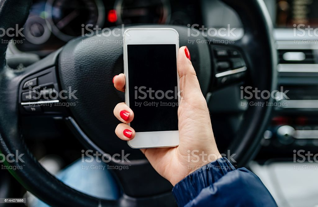 Woman holding a white smartphone with blank screen stock photo