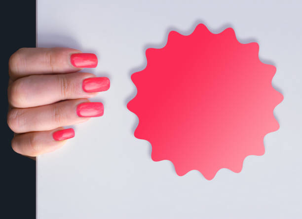 Woman holding a whiteboard with a price rosette Woman with ruby nails  holding a whiteboard with a empty ruby price rosette pink nail polish stock pictures, royalty-free photos & images