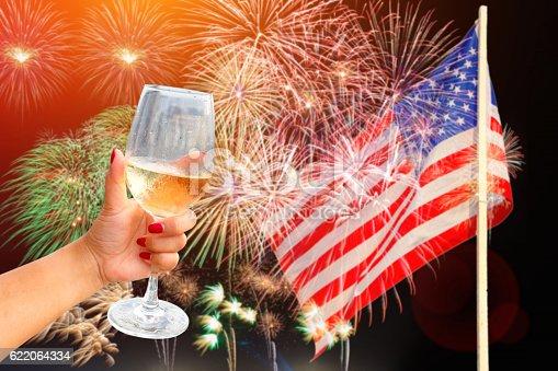 istock Woman holding a wine glass celebratory fireworks 622064334