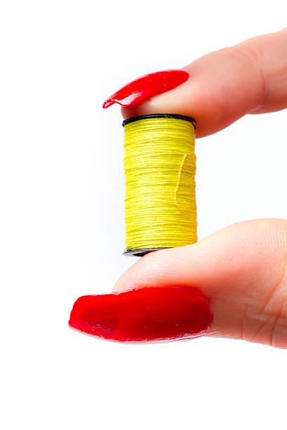 woman holding a yellow spool of yarn stock photo 601125198 istock