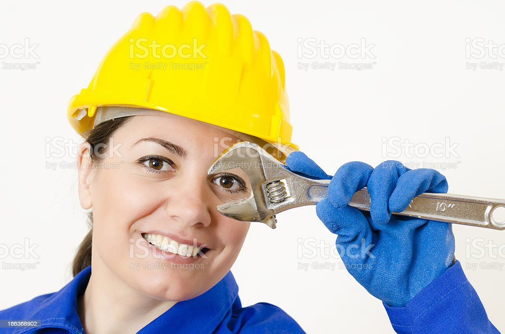 Woman holding Adjustable Wrench royalty-free stock photo