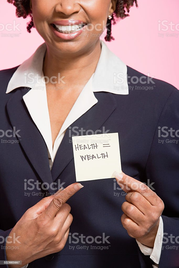 Woman holding an adhesive note stock photo