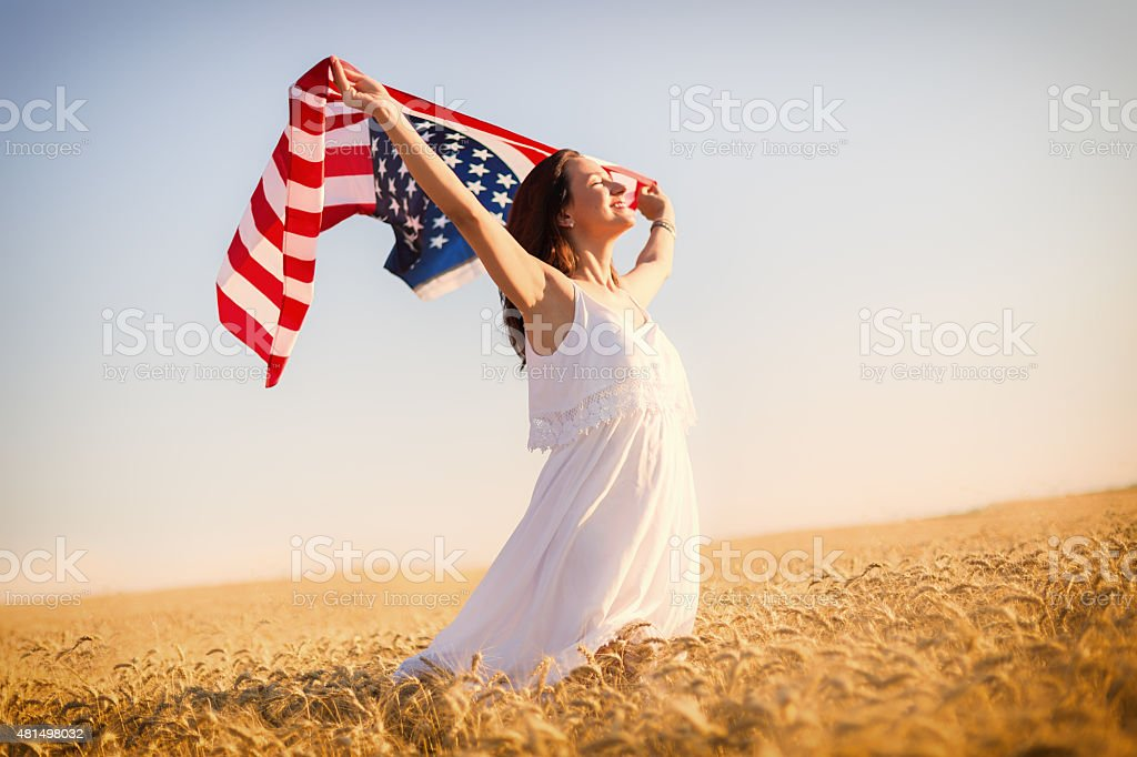 Woman holding an American flag stock photo