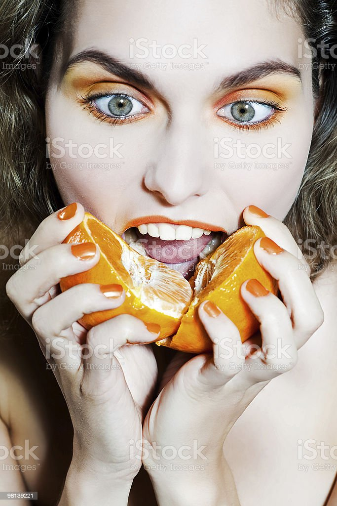 woman holding an citrus fruit royalty-free stock photo