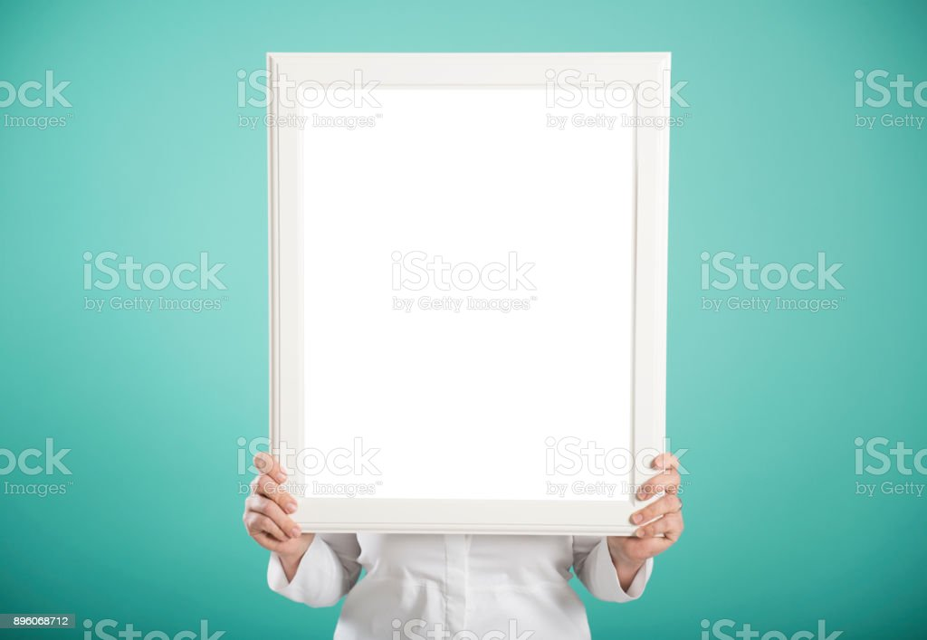 woman holding an empty picture frame sign for your own message stock photo