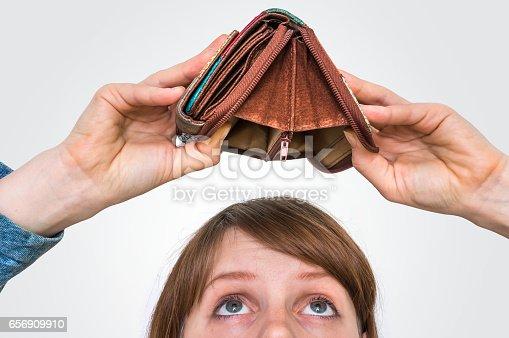 istock Woman holding an empty wallet, she hasn't money 656909910