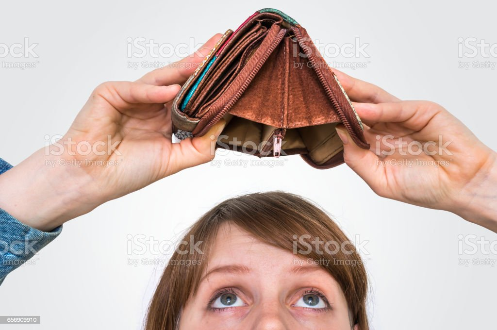 Woman holding an empty wallet, she hasn't money stock photo