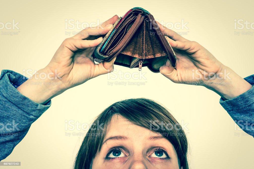 Woman holding an empty wallet, she hasn't money stock photo