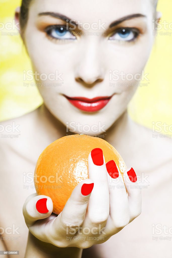 woman holding an orange tangerine citrus fruit royalty-free stock photo