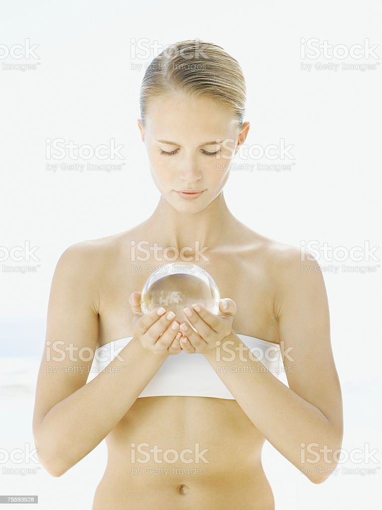 Woman holding an orb in her hands royalty-free stock photo