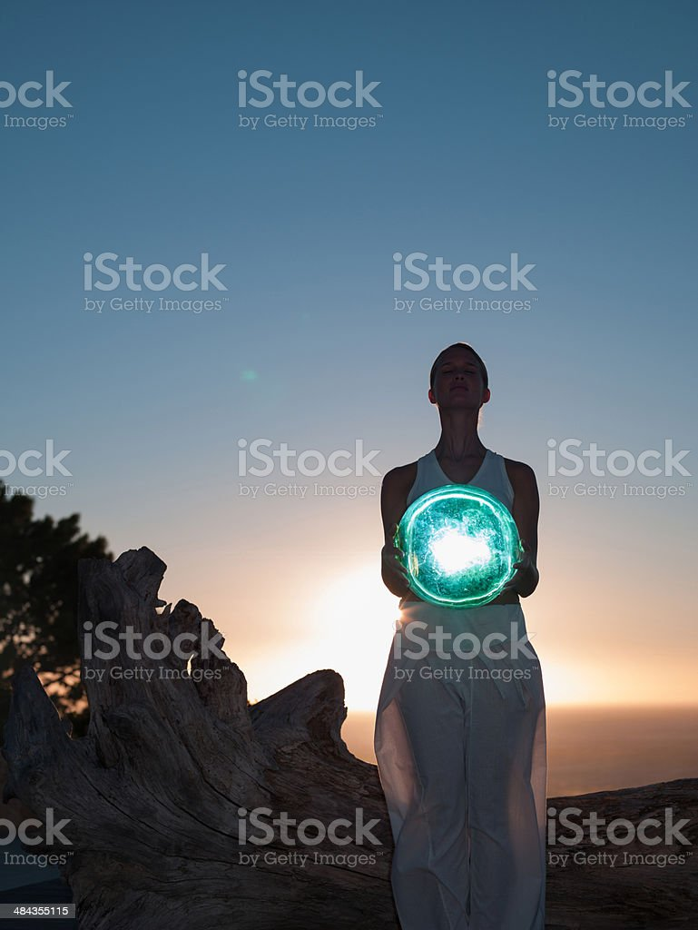 Woman holding an orb stock photo