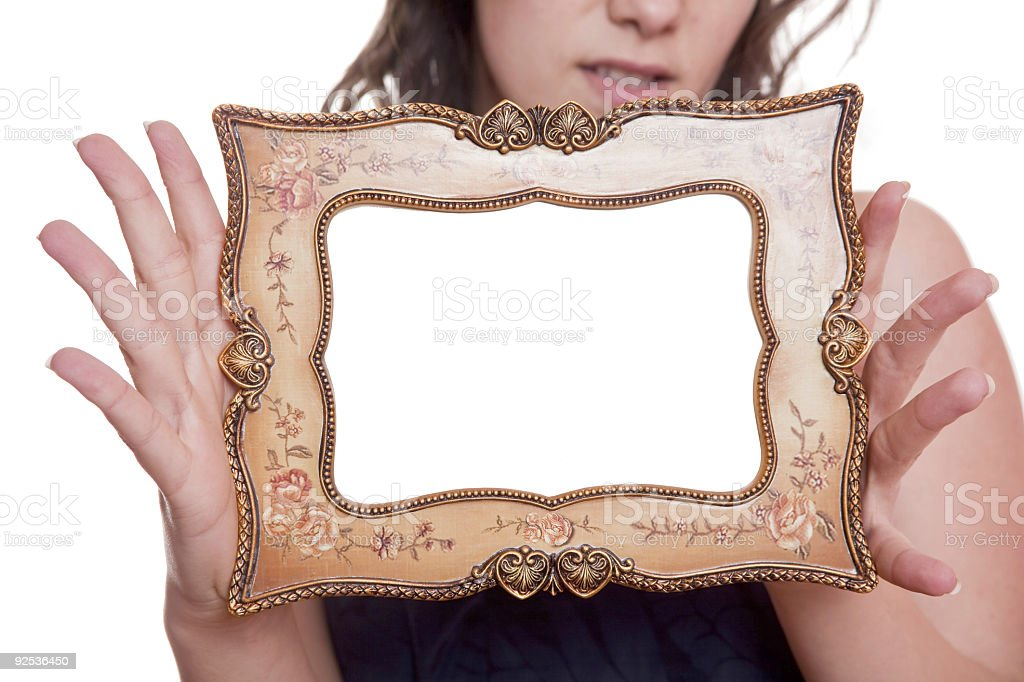 Woman holding an picture frame royalty-free stock photo