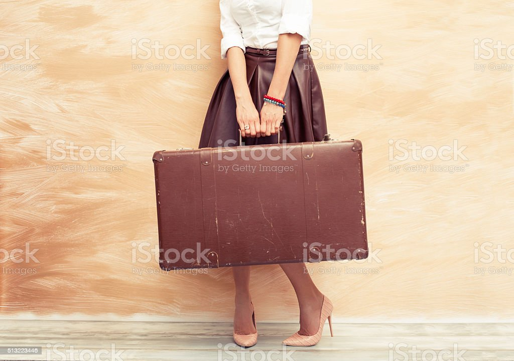 Woman holding antique suitcase for traveling stok fotoğrafı