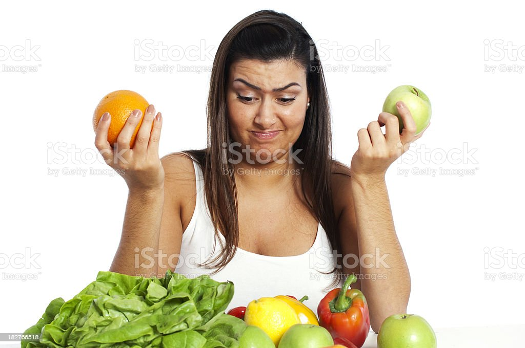 Woman holding apple and orange royalty-free stock photo