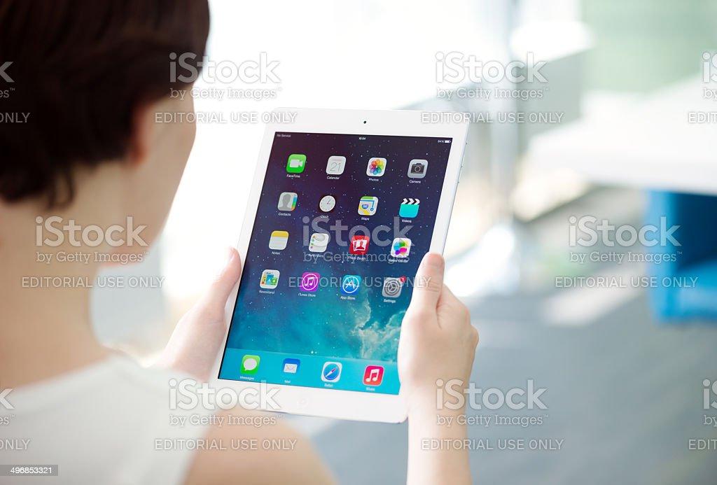 Woman holding Apple iPad Air stock photo