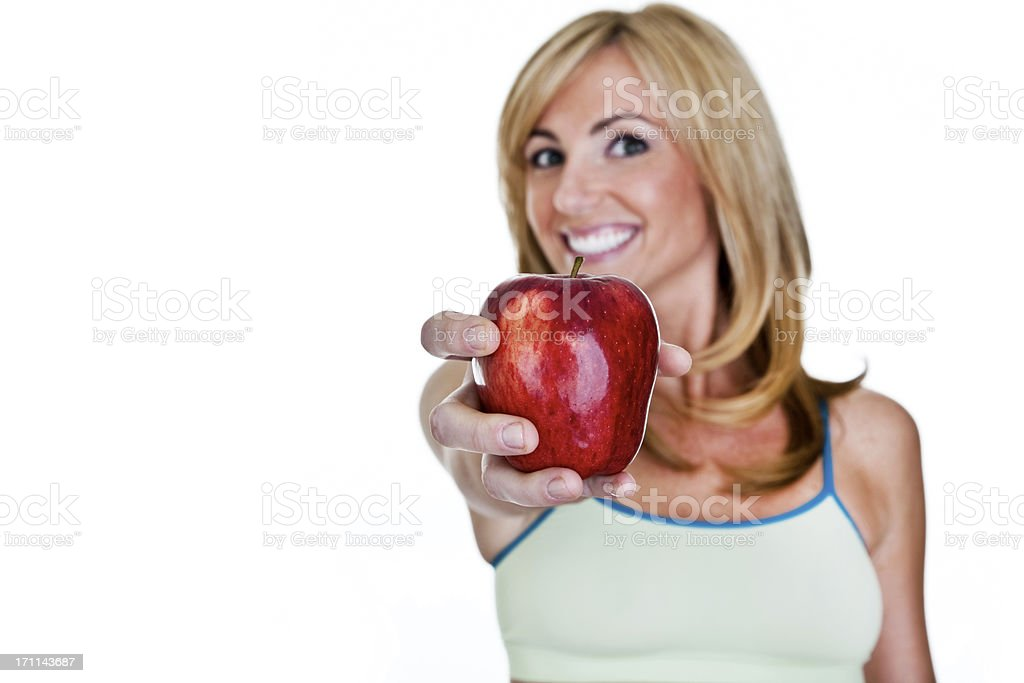 Woman holding apple out royalty-free stock photo