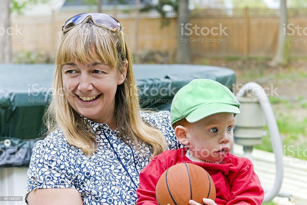 Woman holding baby stock photo