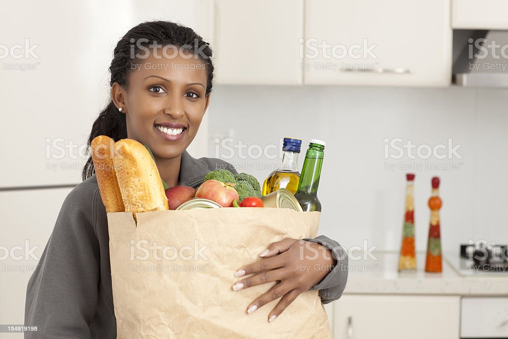 Woman holding bag with supermarket products. royalty-free stock photo