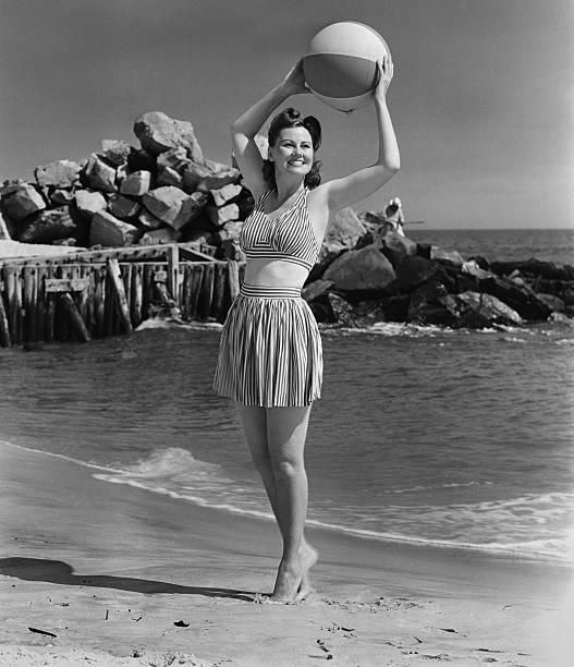 Woman holding ball on beach picture id72688305?b=1&k=6&m=72688305&s=612x612&w=0&h=bc lh7kuiwbwe nacecpcqh sclv1zuqfbwrjjg2f c=