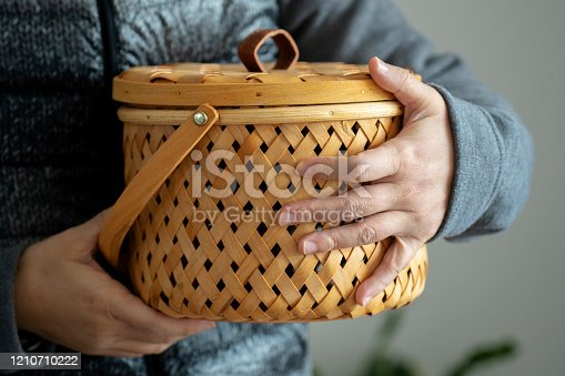 woman holding bamboo weaved basket