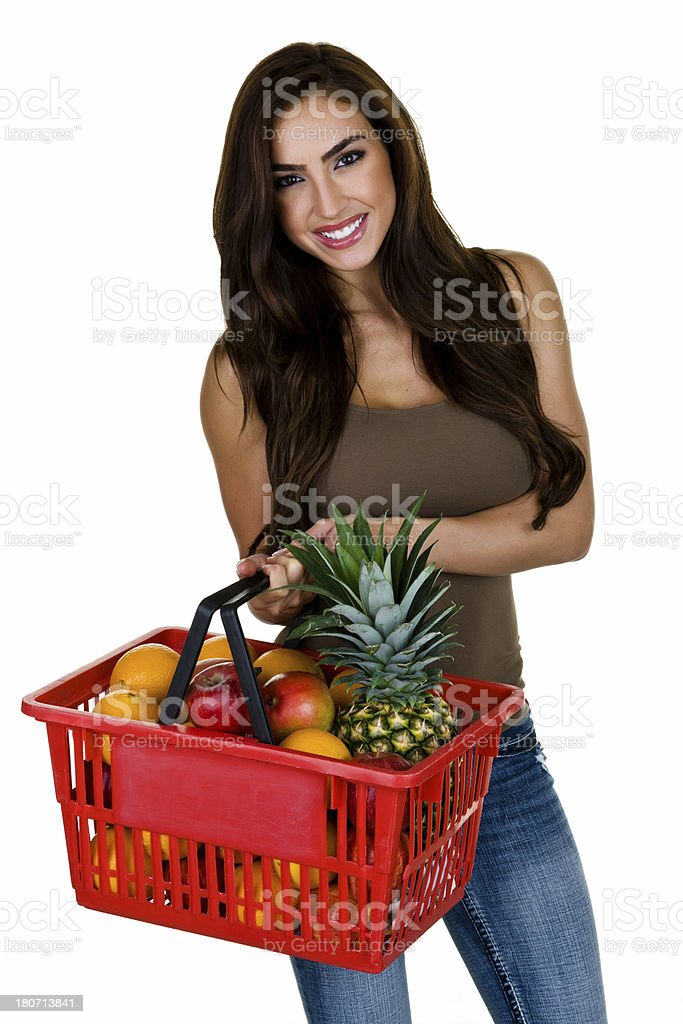 Woman holding basket filled with fruit royalty-free stock photo