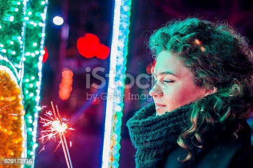 istock Woman holding bengal light at night,orange light,romantic 629172116