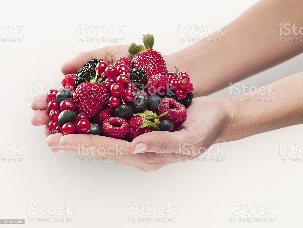 Woman holding berries stock photo