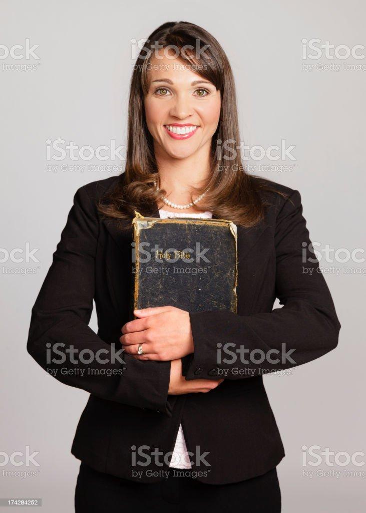 Woman Holding Bible stock photo