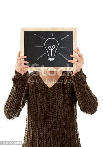 istock Woman Holding Blackboard With Light Bulb 1091485388