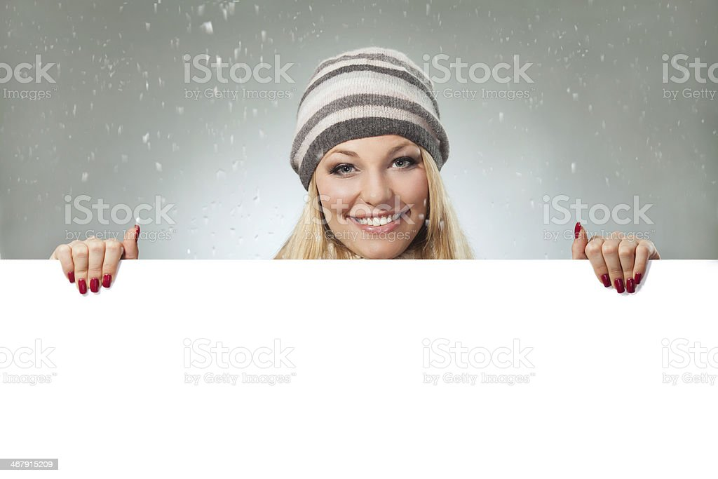 Woman holding blank banner royalty-free stock photo
