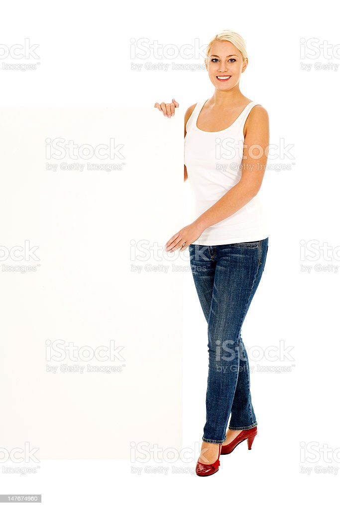 Woman holding blank billboard royalty-free stock photo
