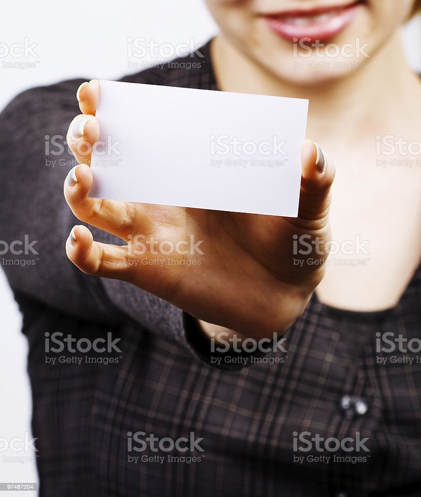Woman holding blank business card royalty-free stock photo