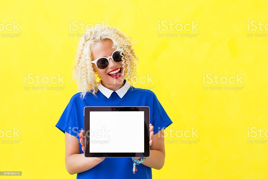 Woman holding blank screen tablet stock photo