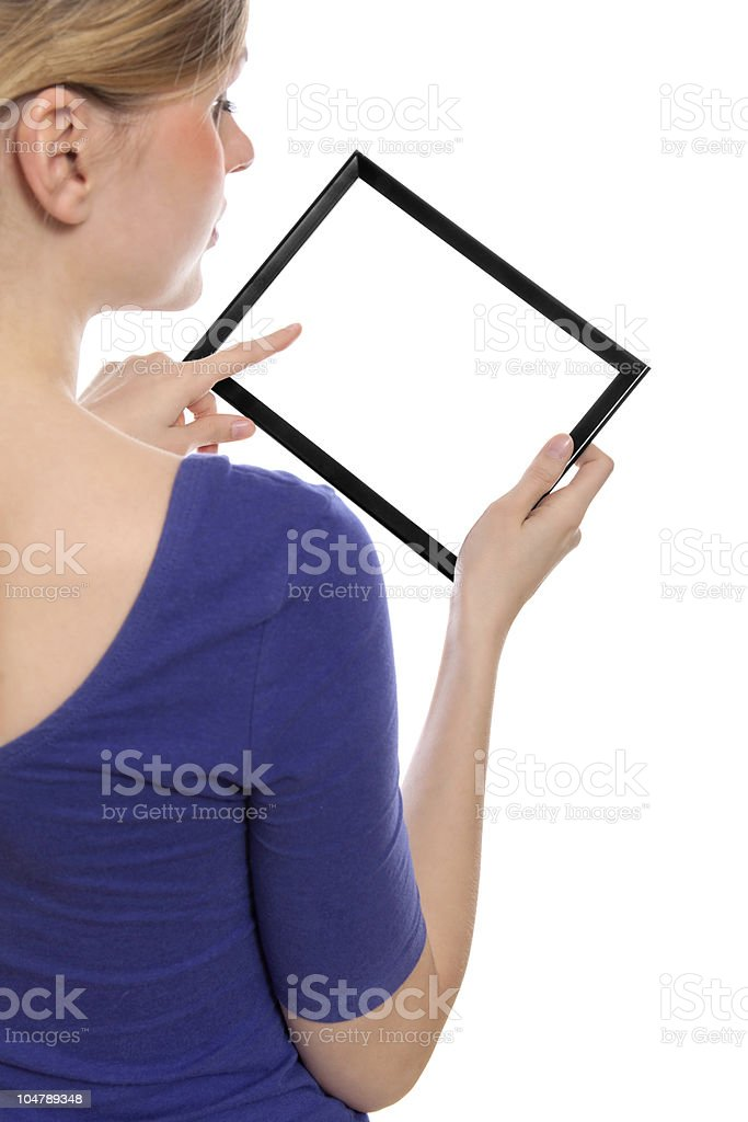 Woman holding blank touchpad pc, 1 finger touches the screen royalty-free stock photo