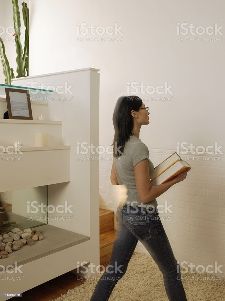 Woman holding books royalty-free stock photo