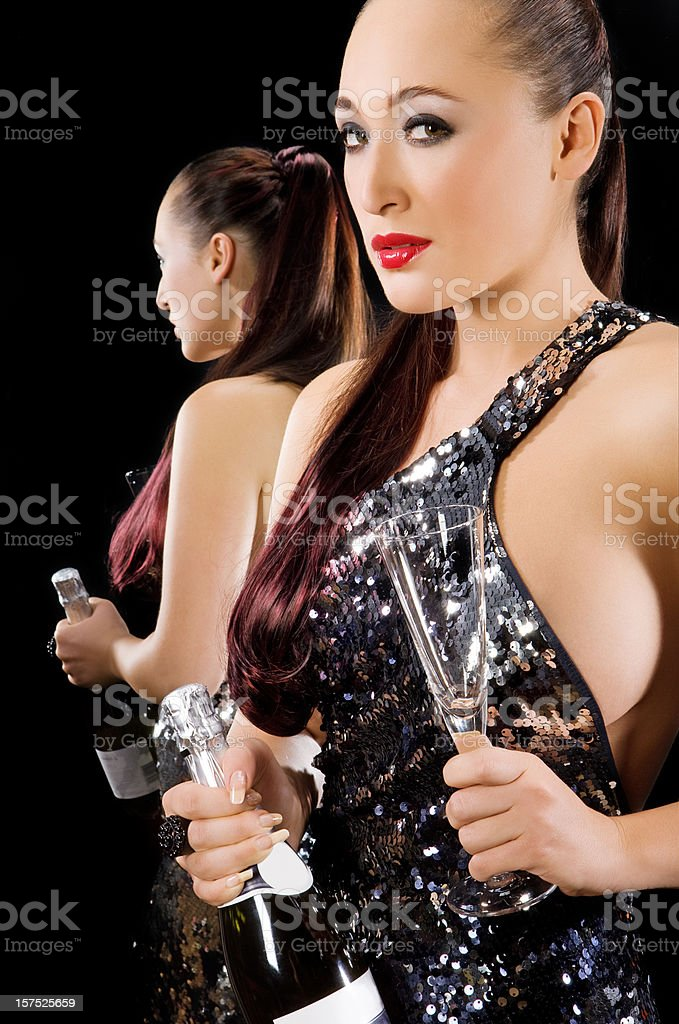 woman holding bottle of shampagne royalty-free stock photo