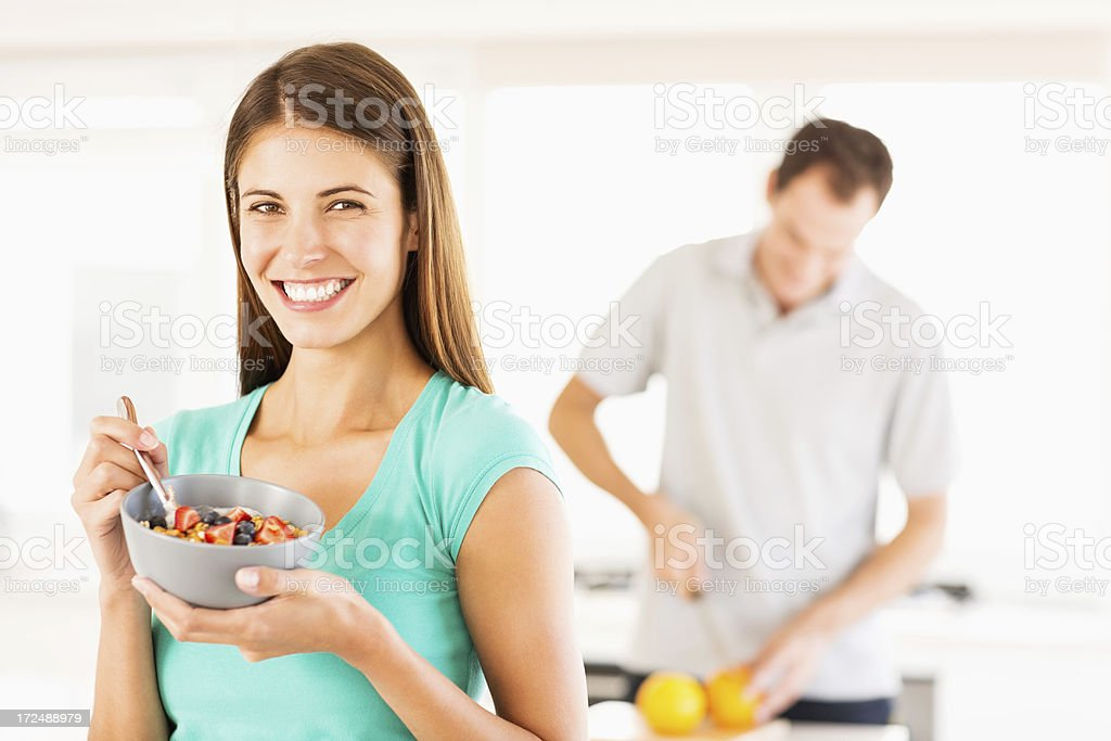 Woman Holding Bowl Of Fruit Salad royalty-free stock photo