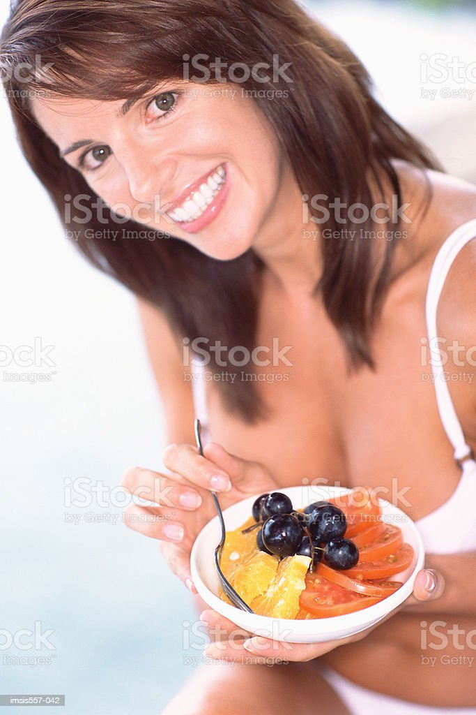 Woman holding bowl of salad royalty-free stock photo