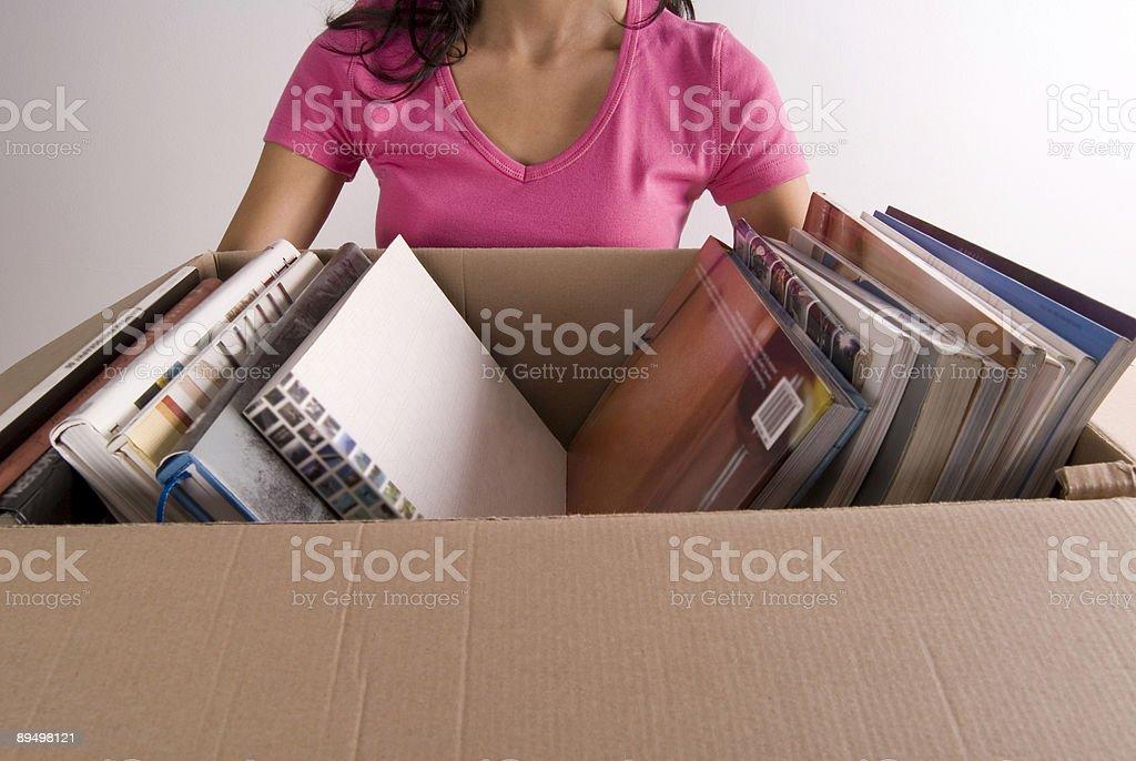 Woman Holding Box of Books royaltyfri bildbanksbilder