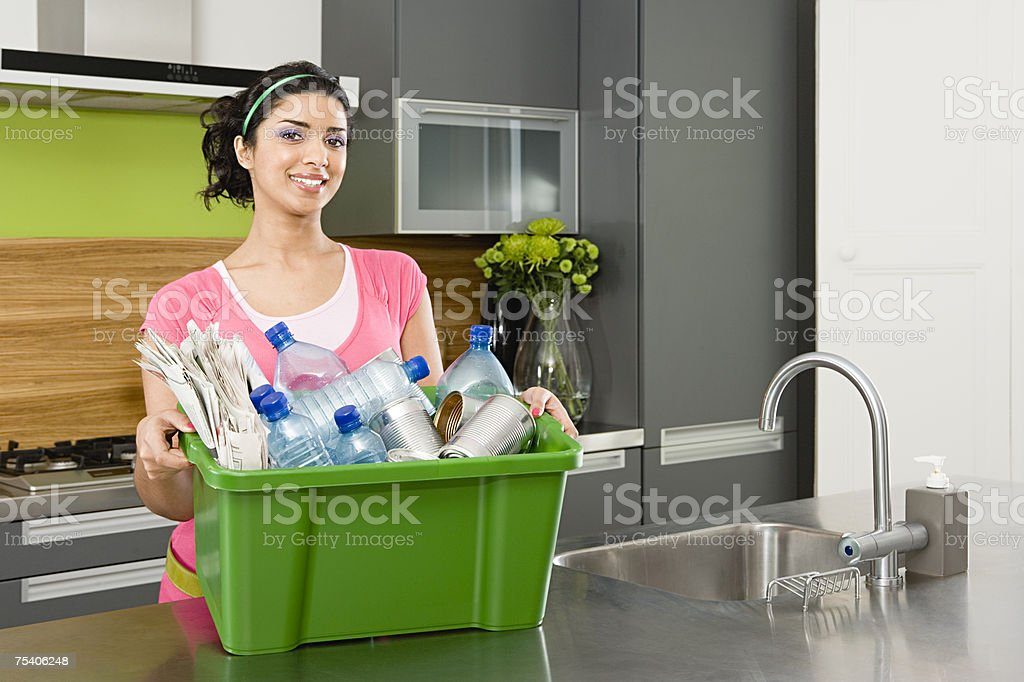 Woman holding box of recycling royalty-free stock photo