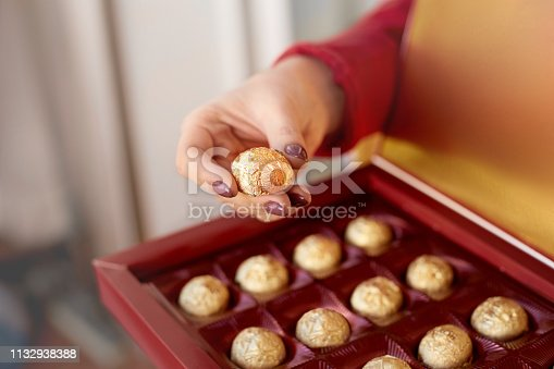 Woman holding box with chocolate candy. Happy valentines gift concept