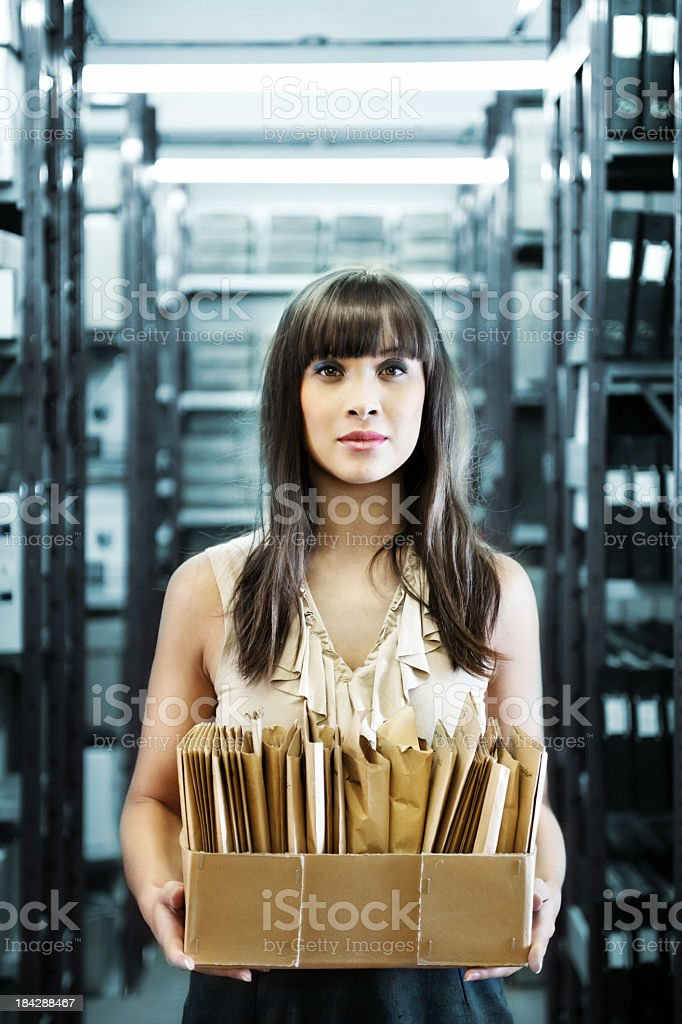 Woman holding box with old photographs stock photo