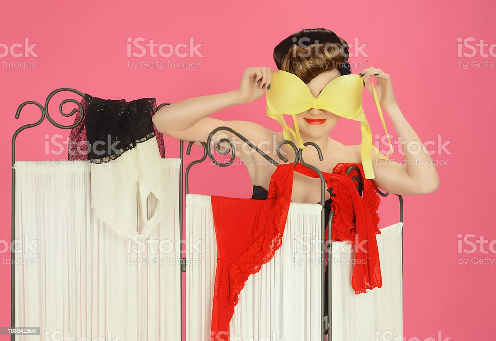 woman holding bra stock photo