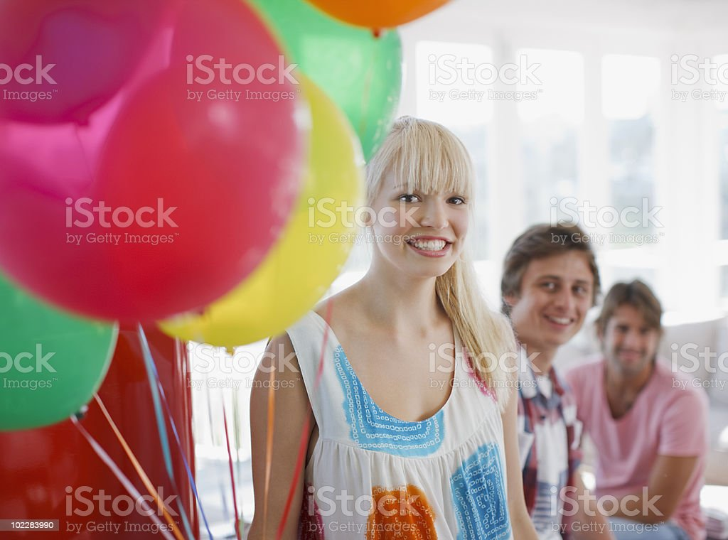 Woman holding bunch of balloons royalty-free stock photo