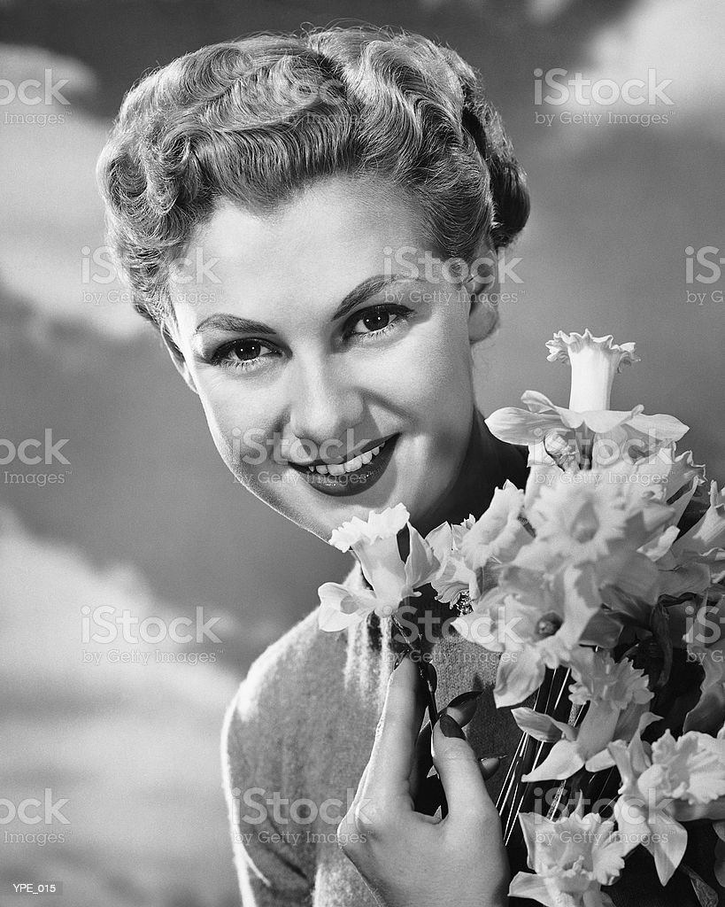 Woman holding bunch of daffodils royalty-free stock photo