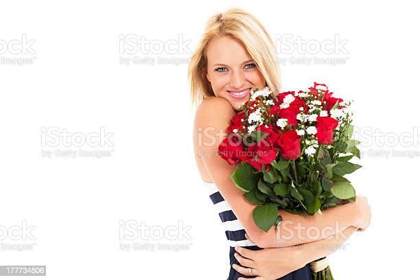 Woman holding bunch of roses picture id177734506?b=1&k=6&m=177734506&s=612x612&h=oiuhwzmwizapq6uymwqidxjzyemnkvunf9lani7fv1a=