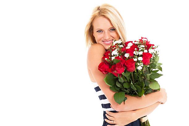 Woman holding bunch of roses picture id177734506?b=1&k=6&m=177734506&s=612x612&w=0&h=dx9htwyrnwblooju xm 8y6fbf mlmrtrnu6n5rcylc=